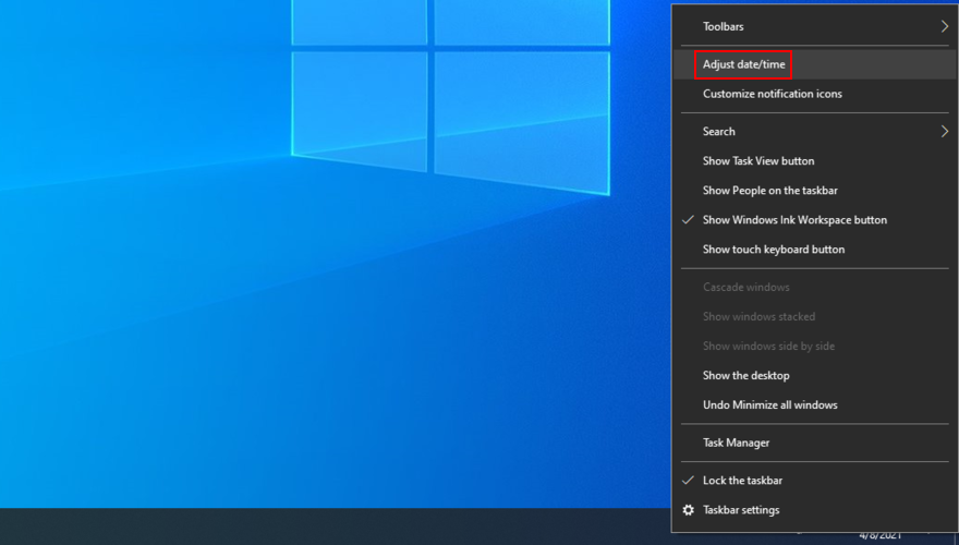 Windows 10 shows how to adjust date and time settings from the systray